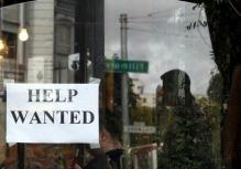 a-help-wanted-sign-is-posted-in-the-window-of-a-restaurant-in